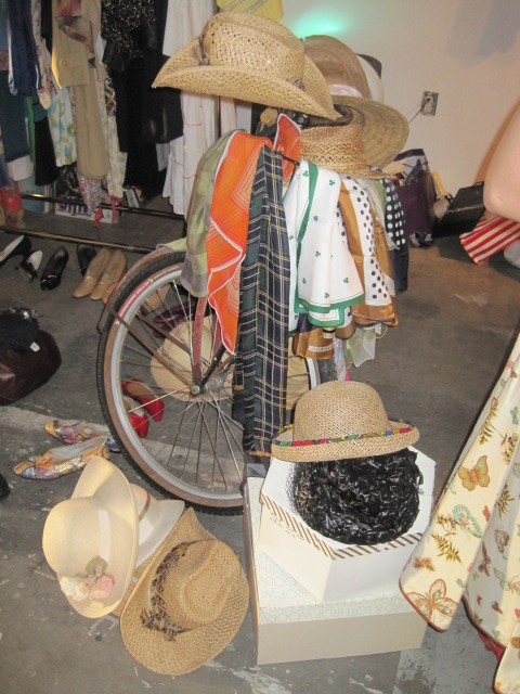 display of vintage hats on bike