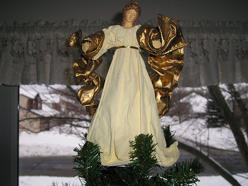 angel ornament on christmas tree