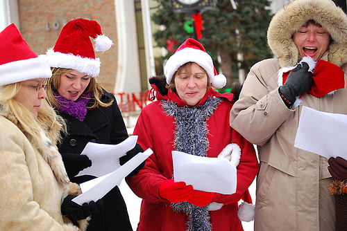 christmas carolers singing