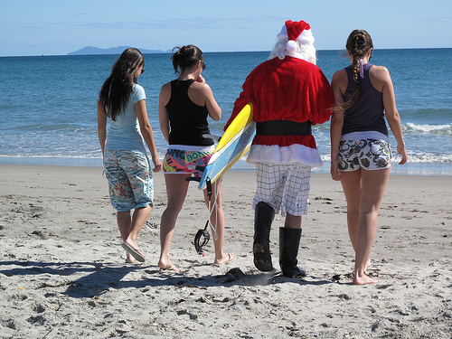 santa surfing on beach