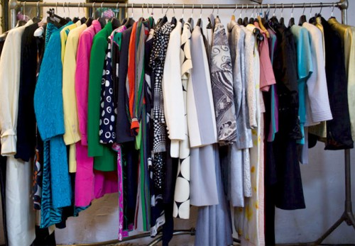 rack of designer vintage clothes