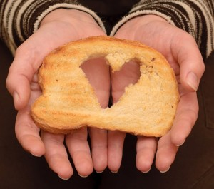 a heart cut out in a piece of toast