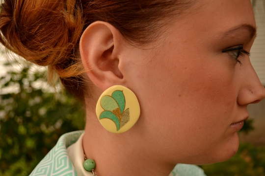 vintage circle earrings shown on an ear
