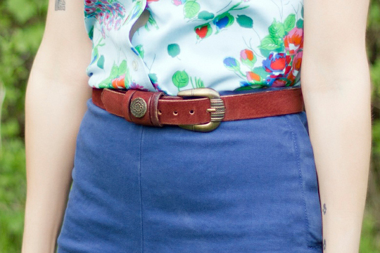 vintage belt styled with high waisted denim and a 1970s floral shirt