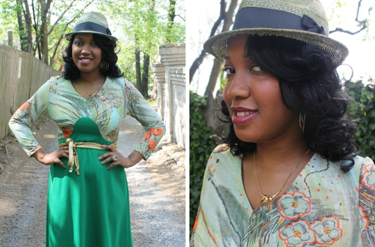 fashion blogger stylish thought wearing a fedora hat and gold waist tie belt with a green 1970s maxi dress