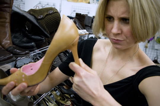 Thrift-Shopping-examine-heel
