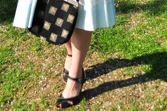 black shoes and black vintage bag