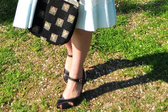 black shoes and black vintage bag