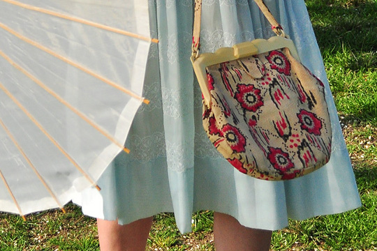 parasol umbrella and vintage needlepoint bag
