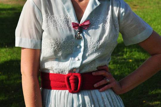 red waist belt worn with a vintage 1950s shirtwaist dress