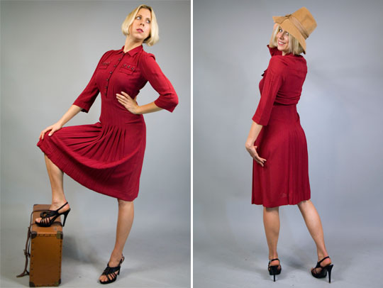 a model wearing a 1940s red military dress