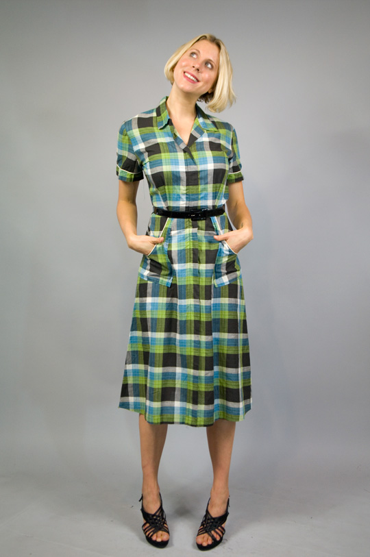 a 1940s country plaid dress with pockets