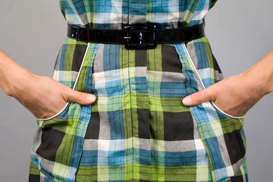 close up of the waist, belt and pockets of a 1940s country plaid dress