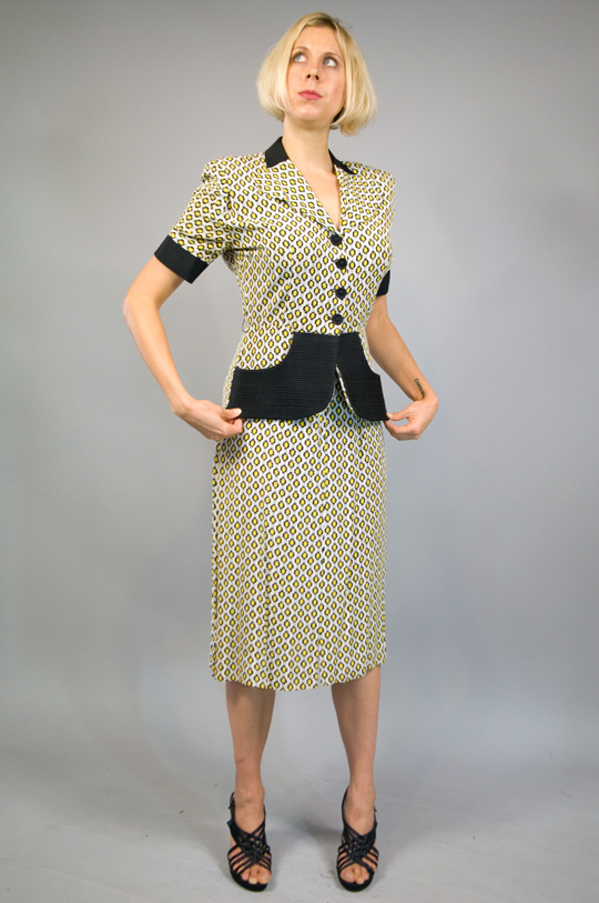 a 1940s suit style one piece dress