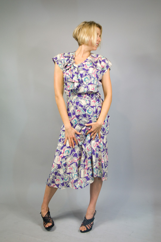a 1940s novelty print rayon dress with clown character design