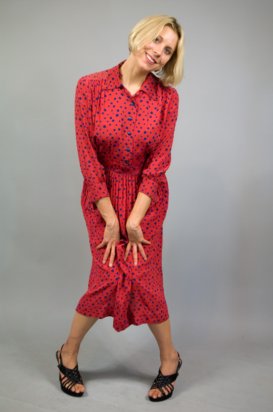 a 1940s rayon dress in a polka dot pattern on a red base