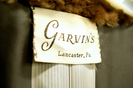 label on vintage fur garment shopped at a thrift store