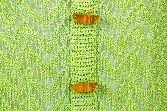 lucite buttons of a 1930s knit suit