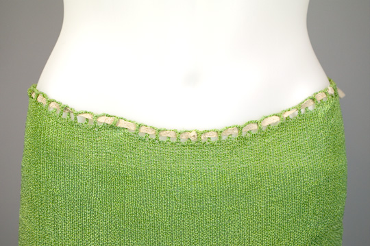the detailed trim of a knit top from the 1930s