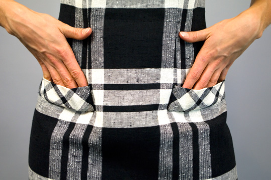 faux pockets on a 50s black and white plaid dress