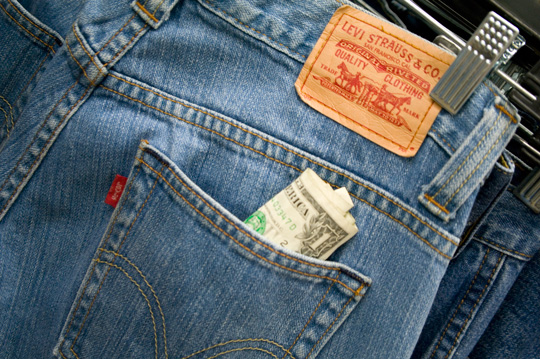pair of levis with a dollar bill sticking out of back pocket