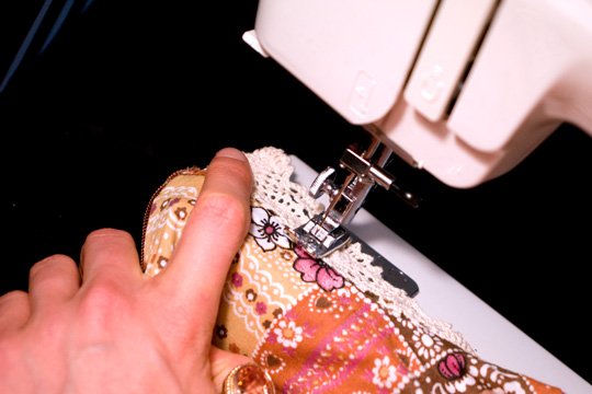 sewing machine stitching the lace of a vintage garment