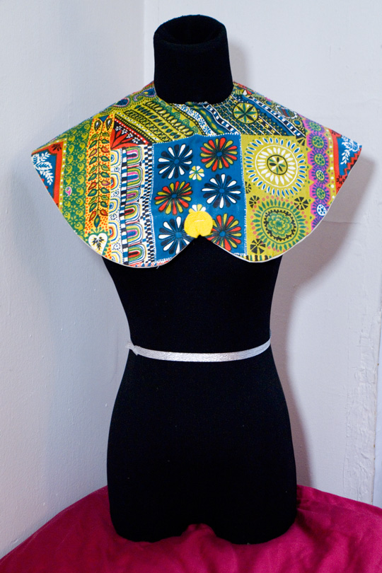 a multi pattern patchwork bib on a black mannequin