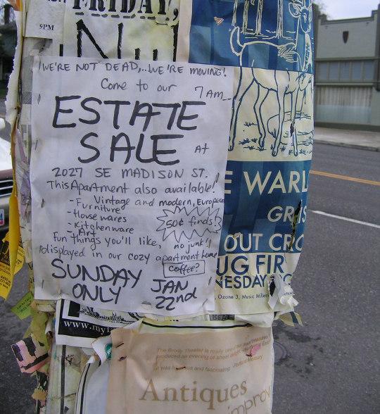 estate sale flyer on an electricity pole