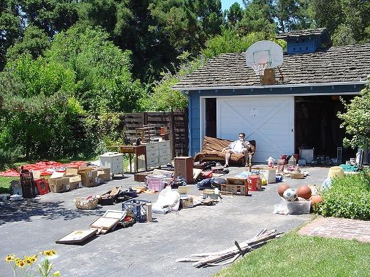 suburban garage sale in a driveway
