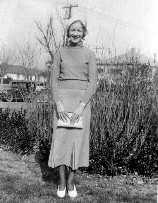 a woman in dallas wearing a jersey knit 1930s suit