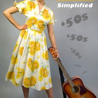 1950s fashion in a sunflower dress