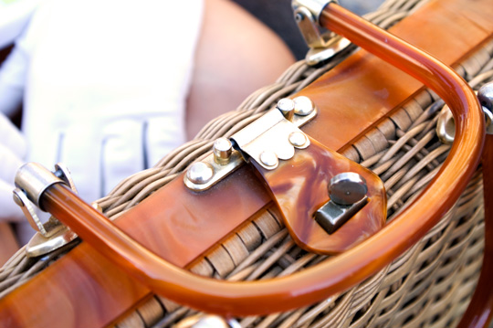 the lucite handles of a 1950s wicker purse