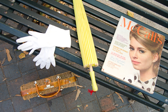 vintage accessories and a vintage 1960s mccall magazine on a park bench