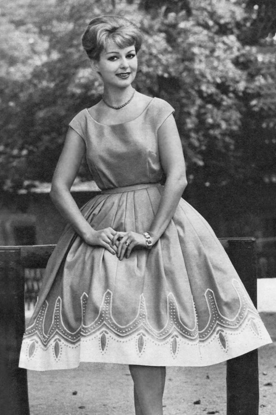 a woman wearing a 1950s circle skirt