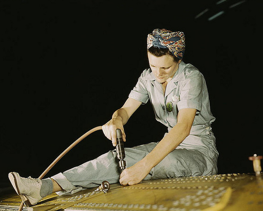 a women wears pants while working during the 1940s