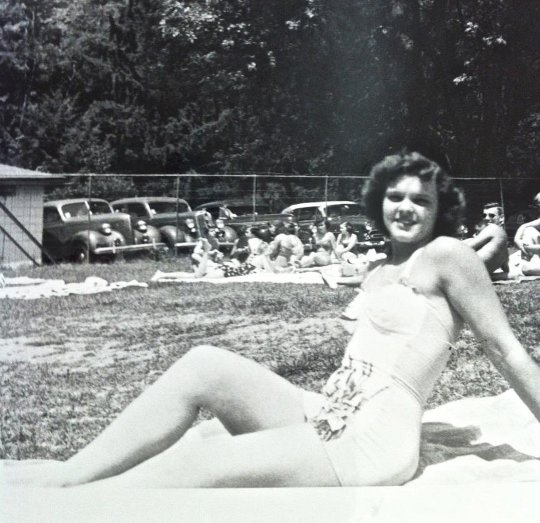 1950s woman sunbathing