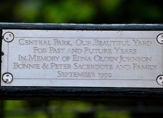 a plaque on a central park bench