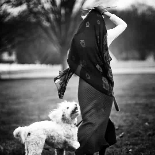sammy davis wears a 1970s vintage dress from emotional outlet vintage with her goldendoodle mac